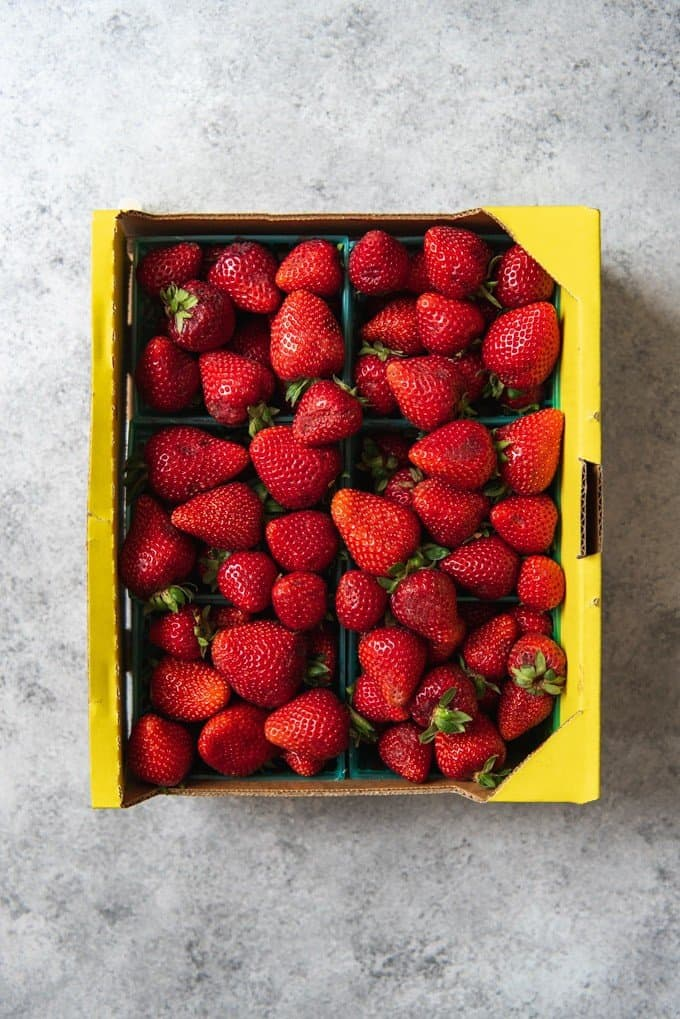 An image of a half flat of fresh strawberries from the farmer's market.