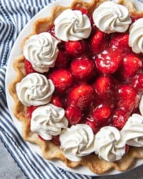 Make this Fresh Strawberry Pie without Jell-O before summer is over!  A classic buttery crust gets loaded with juicy, fresh strawberries coated in a strawberry glaze made from scratch and then topped with plenty of sweetened whipped cream.  It's so good!