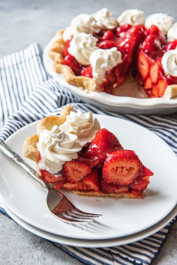 An image of a slice of homemade strawberry pie made without Jello or gelatin.