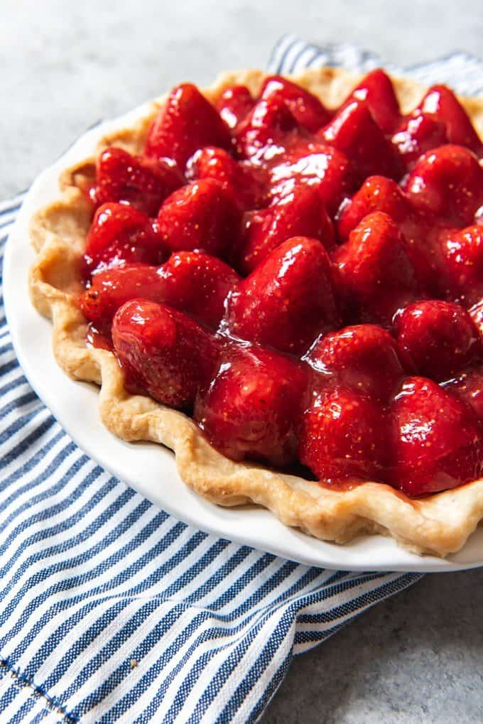 An image of a fresh strawberry pie made with homemade strawberry glaze from scratch.