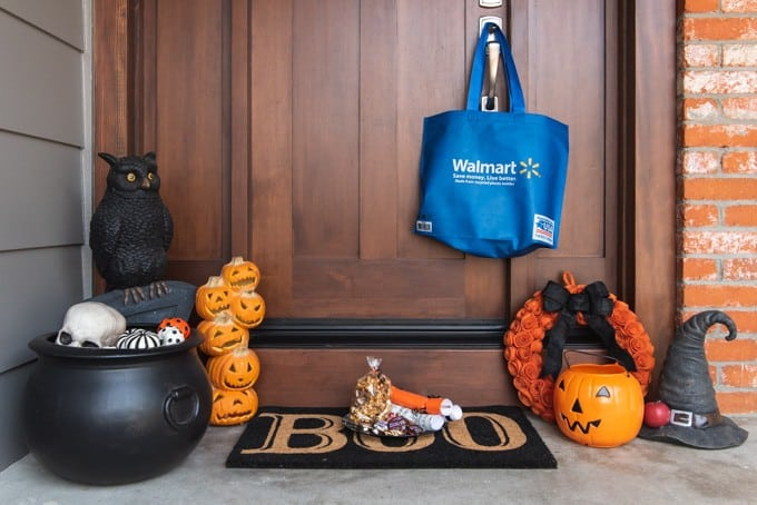 An image of a doorstep decorated for Halloween with a plate of treats from being boo'ed.