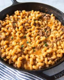 One of our go-to dinner recipes when we are in the throes of busy school schedules and extracurricular activities and I haven't planned ahead is this Homemade Hamburger Helper Cheeseburger Pasta Skillet made with browned ground beef, shredded cheddar cheese, and cavatappi or macaroni noodles.  It's may not be fancy, but it's always easy, satisfying, and a hit with my family!
