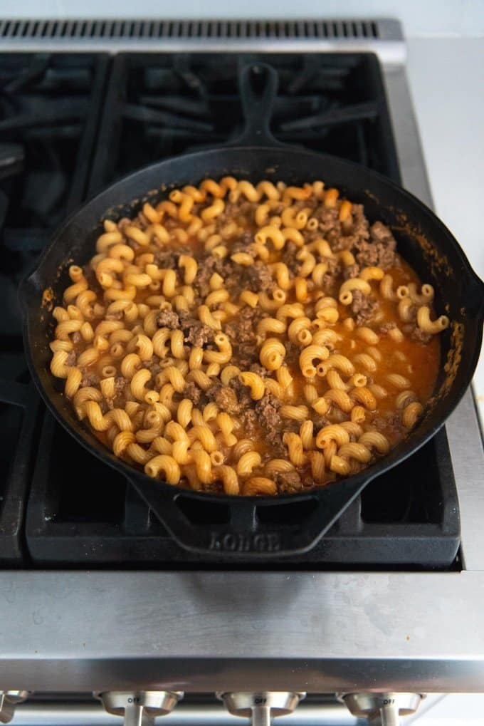 An image showing how to make one pot homemade hamburger helper on the stovetop.