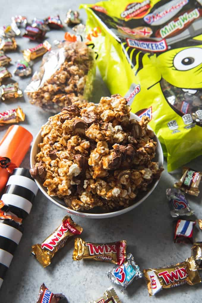 Start a fun new tradition this year by boo'ing friends with TWIX® Caramel Popcorn & Halloween Poppers filled with Mars seasonal Halloween candies and other surprises!