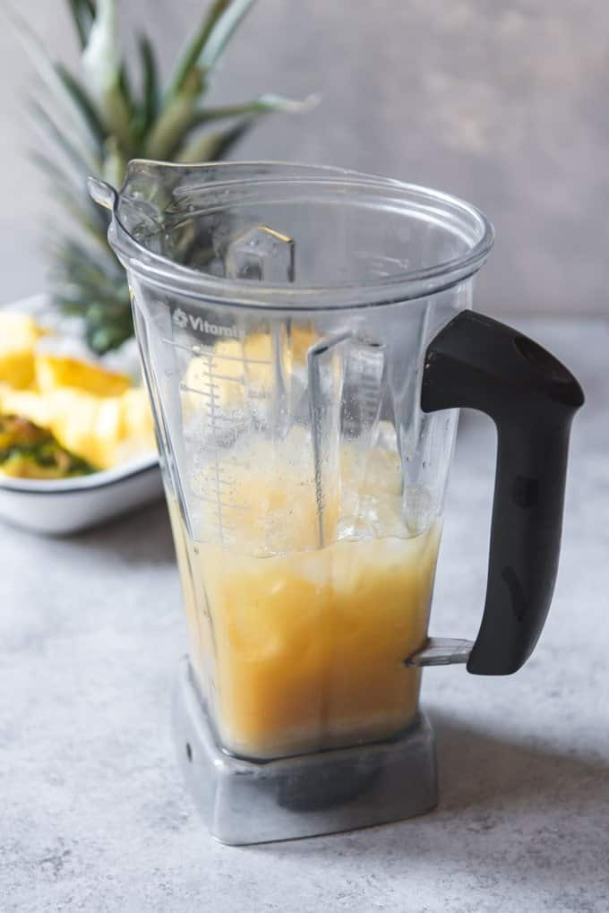 An image of how to make a non-alcoholic pina colada in a vitamix blender.