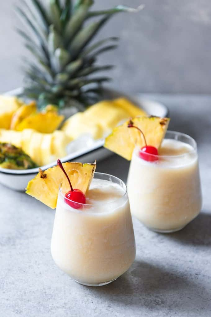 Enjoy a cool, tropical treat this summer with these creamy, refreshing and non-alcoholic Virgin Piña Coladas that are perfect for the whole family to enjoy!  It's a sip of paradise in every glass and will transport you right to the shade of a palm tree on a warm beach, no passport required!
