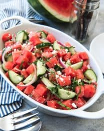 watermelon basil feta salad in a large white baking dish