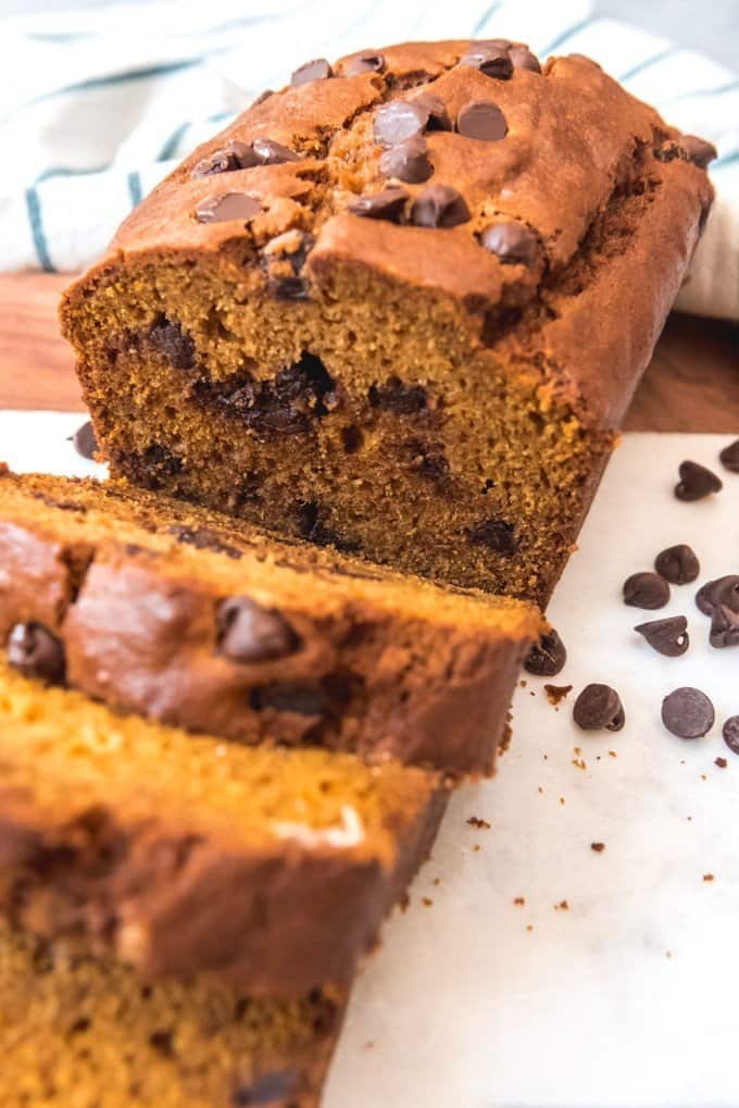 An image of a sliced loaf of chocolate chip pumpkin bread.