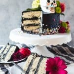 This showstopper Day of the Dead Black Buttercream Cake was inspired by the Dia de los Muertos celebration of remembrance of ancestors and loved ones. It's perfect for anyone who thinks they can't decorate a cake because there is no difficulty piping involved!