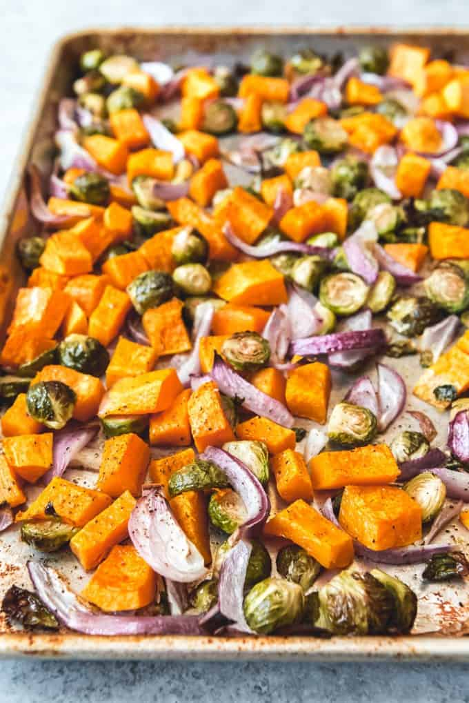 An image of a baking sheet full of roasted vegetables for an easy Fall salad.