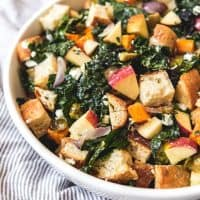 a white bowl filled with Fall Panzanella Salad