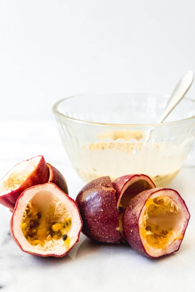 An image of purple passion fruit sliced in half to remove the seeds and pulp for a passion fruit glaze for lemon loaf cake.