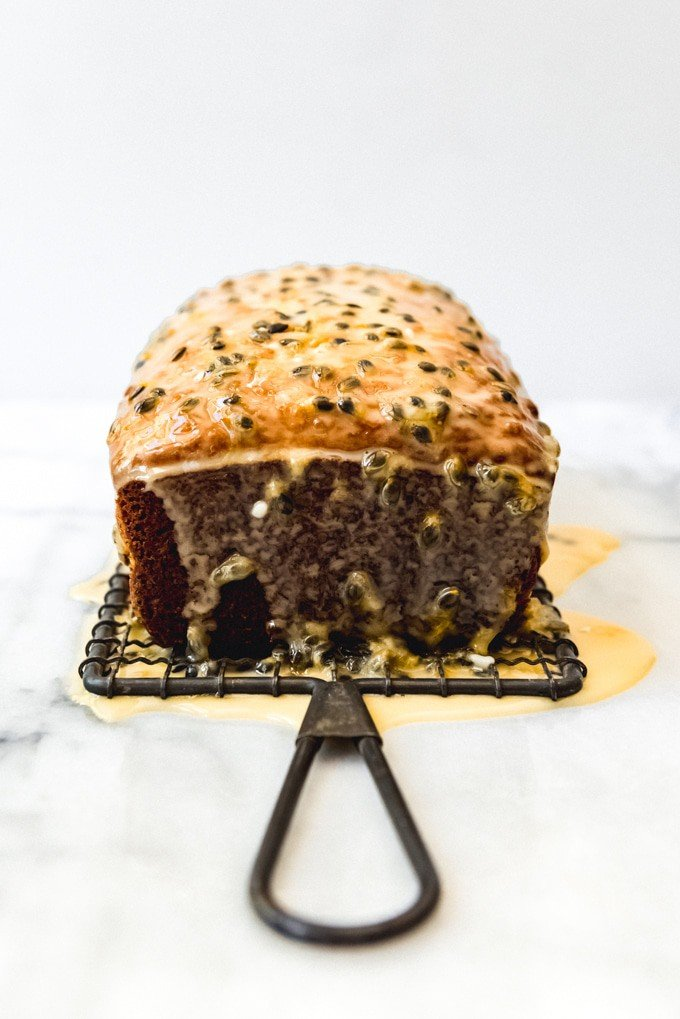 An image of a loaf of lemon bread glazed with a passion fruit glaze.