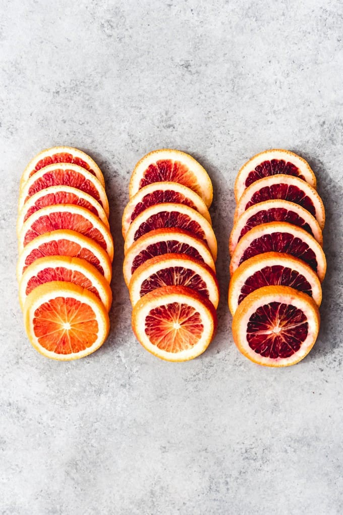 An image of a gradient of sliced blood oranges.