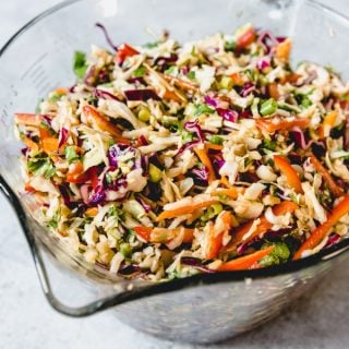 Make this easy Asian Slaw with Ginger Peanut Dressing for a delicious side or to pile on top of pulled pork sandwiches!  This is a fresh and vibrant coleslaw without mayo and is sure to be a hit with your family!