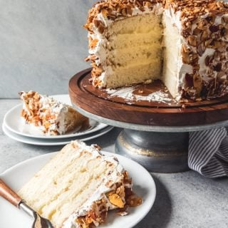 A Burnt Almond Cake is a rustic-looking layer cake, filled with almond pastry cream, slathered in the BEST Swiss meringue buttercream frosting, then covered in candied almonds.  It's famous in San Jose and is a favorite for those of us from the California Bay Area.