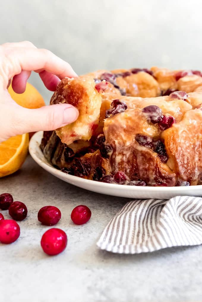 Orange zest and tart cranberries are tucked into every nook and cranny between pillowy soft rolls in this Cranberry Orange Pull Apart Monkey Bread that will be a showstopper at any holiday gathering, whether it's for breakfast, brunch, or dessert!