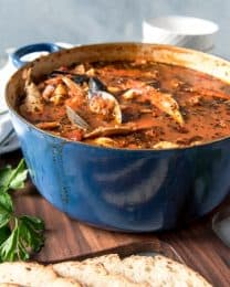 a large blue pot full of cioppino stew