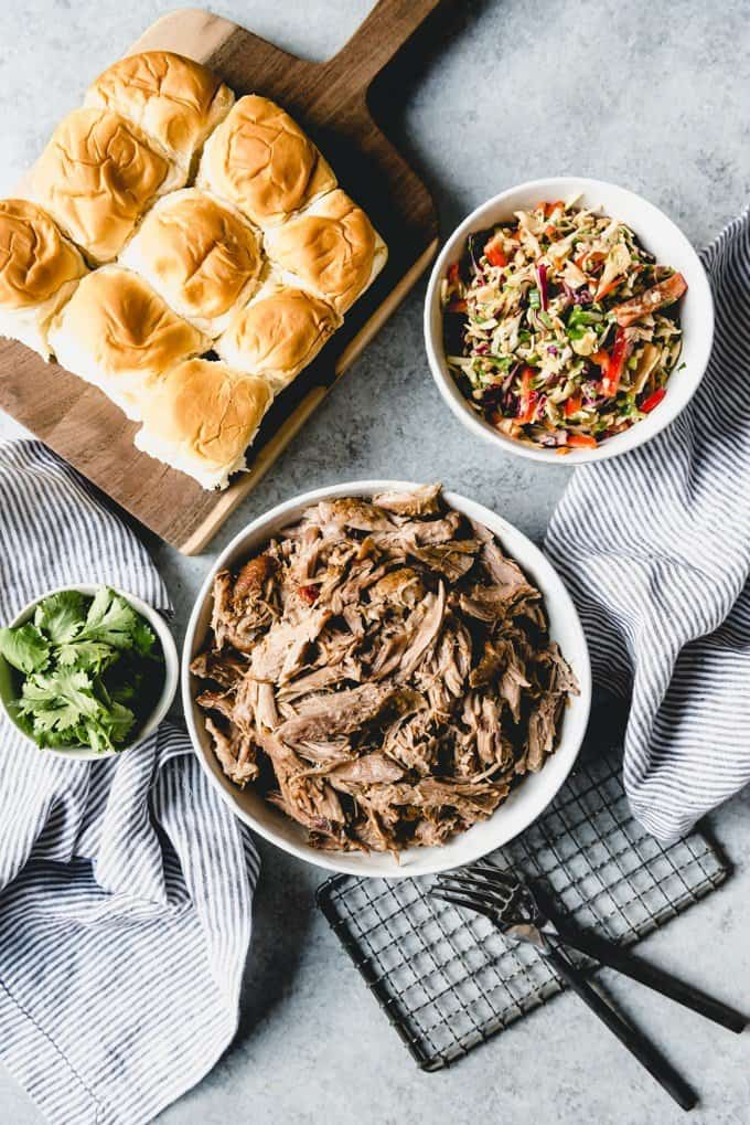 An image of a bowl of shredded Asian pulled pork for sandwiches, sliders, nachos, tacos, burritos, or just served plain over rice.
