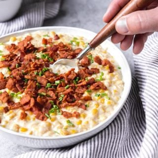 This Slow Cooker Creamed Corn recipe is an easy, classic side dish for your holiday table, made even more special with a savory sprinkle of crispy bacon and chopped chives to complement the natural sweetness of the creamy corn.