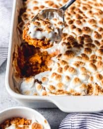 Win over the most averse sweet potato eaters this Thanksgiving with this Sweet Potato Casserole with Marshmallows and Pecans.  It's a family favorite holiday classic that is made even more delightful with both a crunchy pecan streusel topping and roasted marshmallows on top!