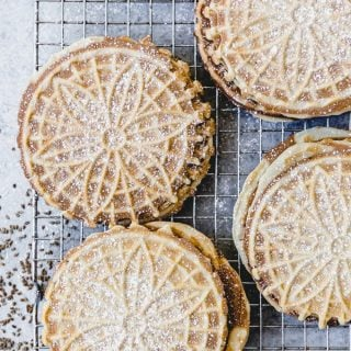 This Authentic Italian Pizzelle Recipe for the classic Italian cookie includes anise extract and anise seeds for a truly traditional pizzelle flavor with a crunchy texture.