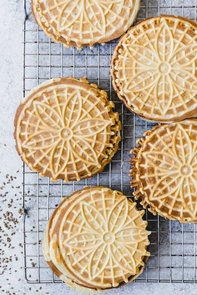An image of classic Italian pizzelles with anise extract and anice seeds for flavor.