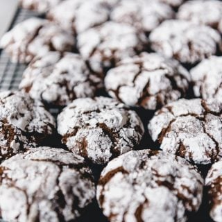 Double Chocolate Crinkle Cookies are a Christmas classic with soft and fudgy centers and a sweet crackled exterior.  Make these for your Christmas cookie platters this year!