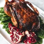 This Honey Roast Duck recipe makes a beautiful holiday main dish but is easy enough for any special occasion or Sunday dinner.  With crispy skin and tender, juicy meat, this post will show you how to cook duck to get that beautiful roasted look and amazing flavor!