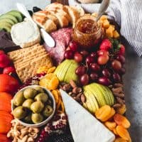 a fruit and cheese platter with a ton of options