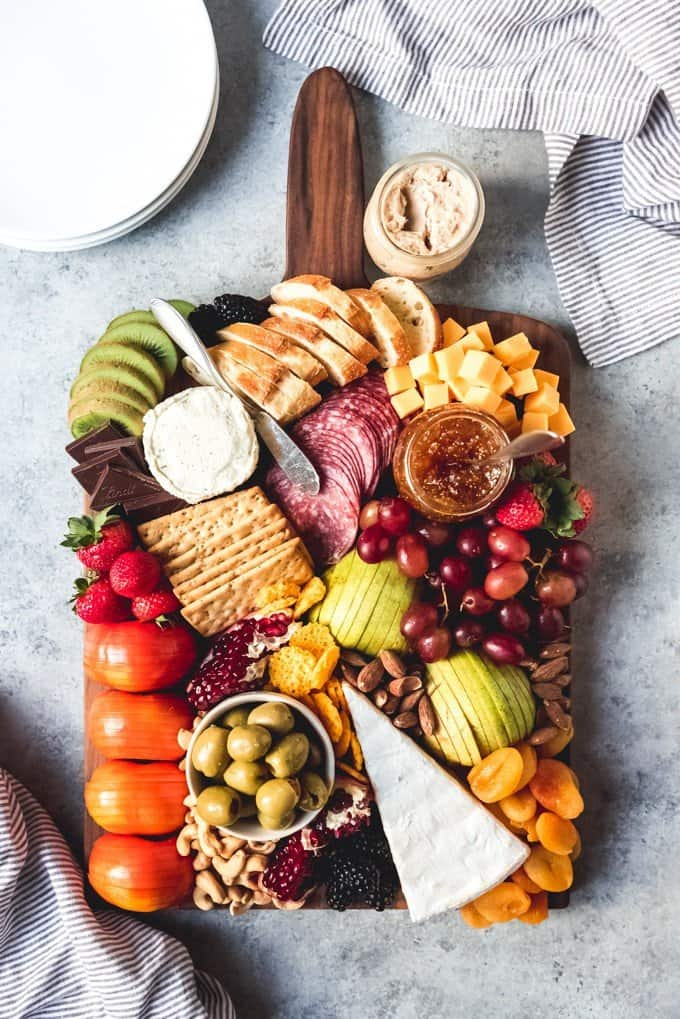Learn how to make the best fruit and cheese platter that is perfect for entertaining anytime of the year with this easy tutorial!  This is more than just cheese and crackers.  It can be an elegant and impressive spread that is sure to delight guests.