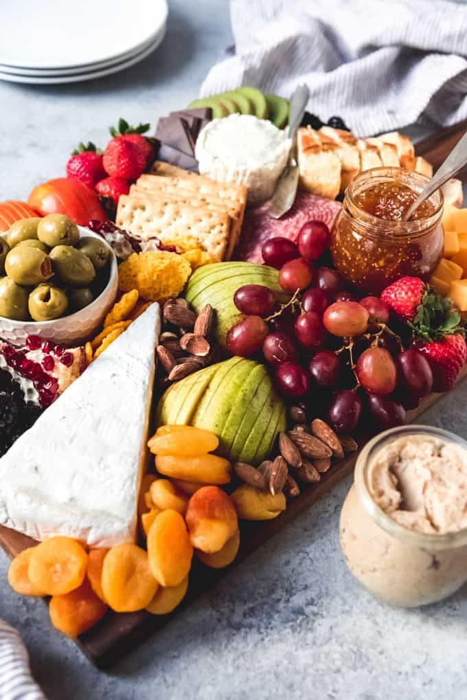 An image of a fruit and cheese board for easy holiday entertaining as an appetizer.