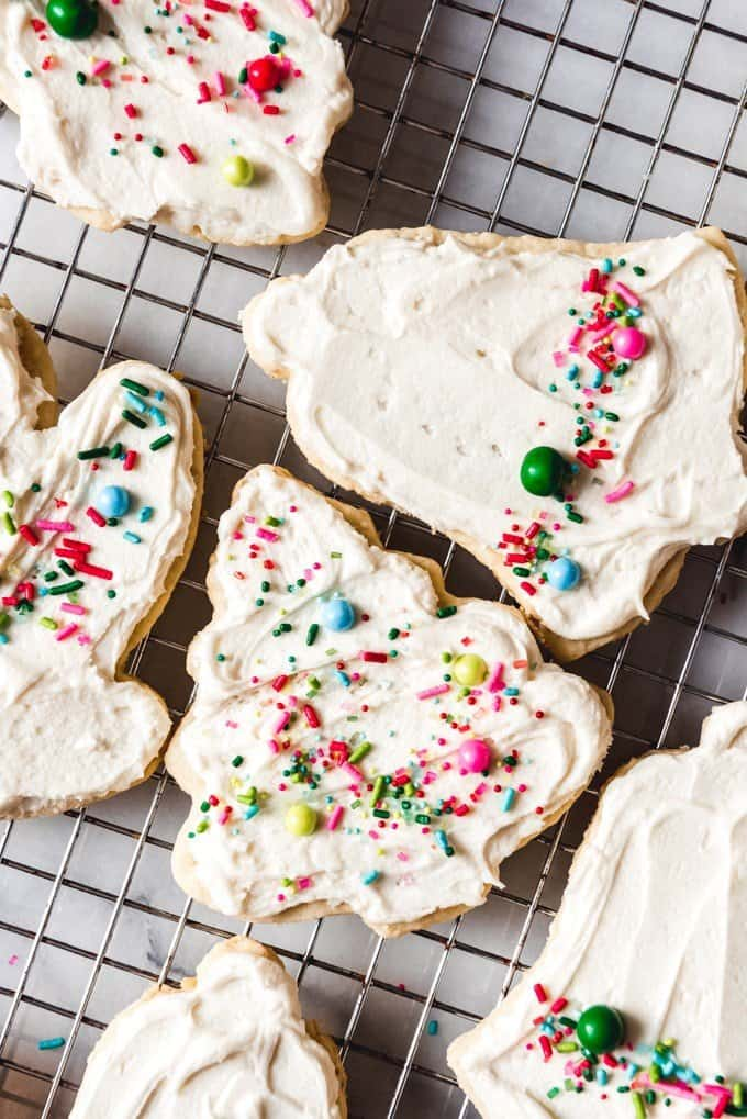 An image of frosted sugar cookies decorated with a colorful sprinkles mix are perfect for Christmas cookie platters.