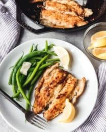 The Rocky Mountains are known as a prime fishing destination, and as such, rainbow trout is often on the menu in Colorado, whether that's at a restaurant, in homes, or at campsites. This easy, classic Pan Fried Trout recipe makes a delicious, quick dinner of store-bought or fresh caught rainbow trout by lightly dredging it in seasoned flour then quickly searing it in a hot skillet with a little butter.