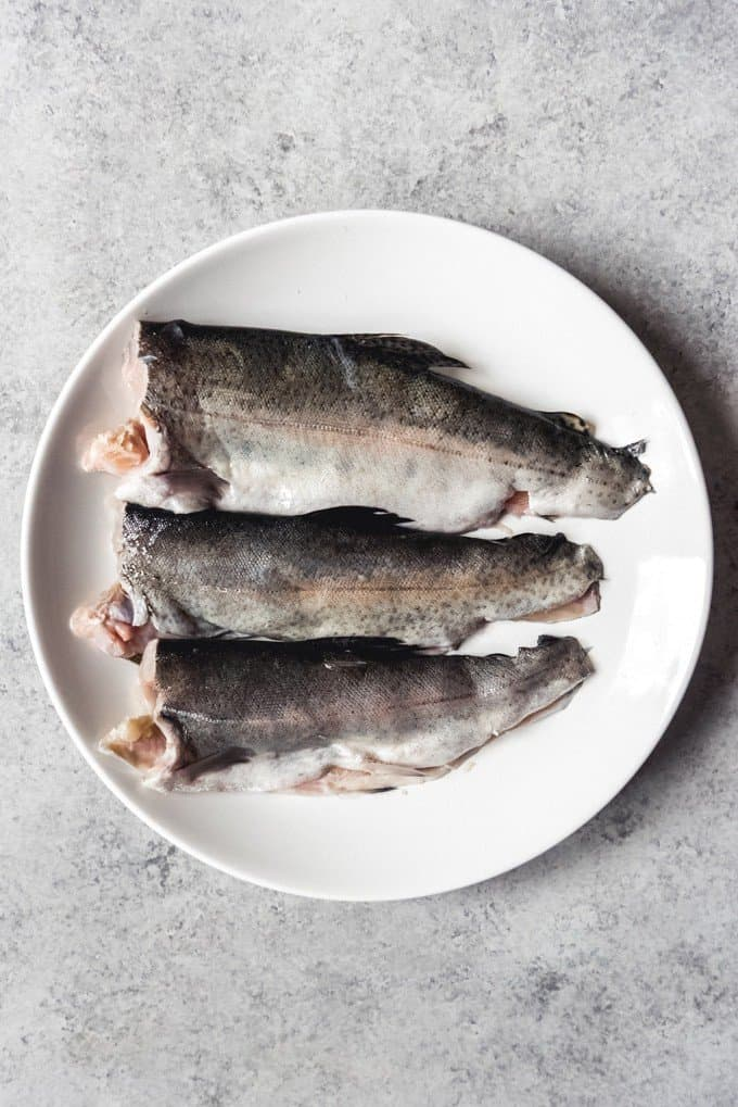 An image of three filleted rainbow trout.