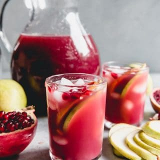 Pomegranate in a Pear Tree Punch is a fun, festive non-alcoholic holiday drink that is quick and easy to make and perfect for any Christmas party or other holiday gathering!