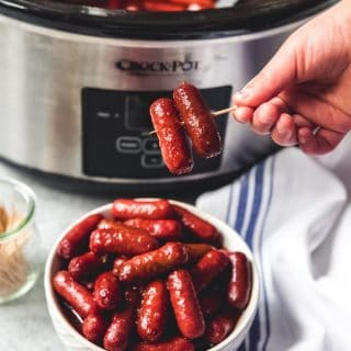 Slow Cooker Little Smokies in Honey Garlic BBQ Sauce are one of the easiest, tastiest party foods ever and perfect for your next Game Day event!