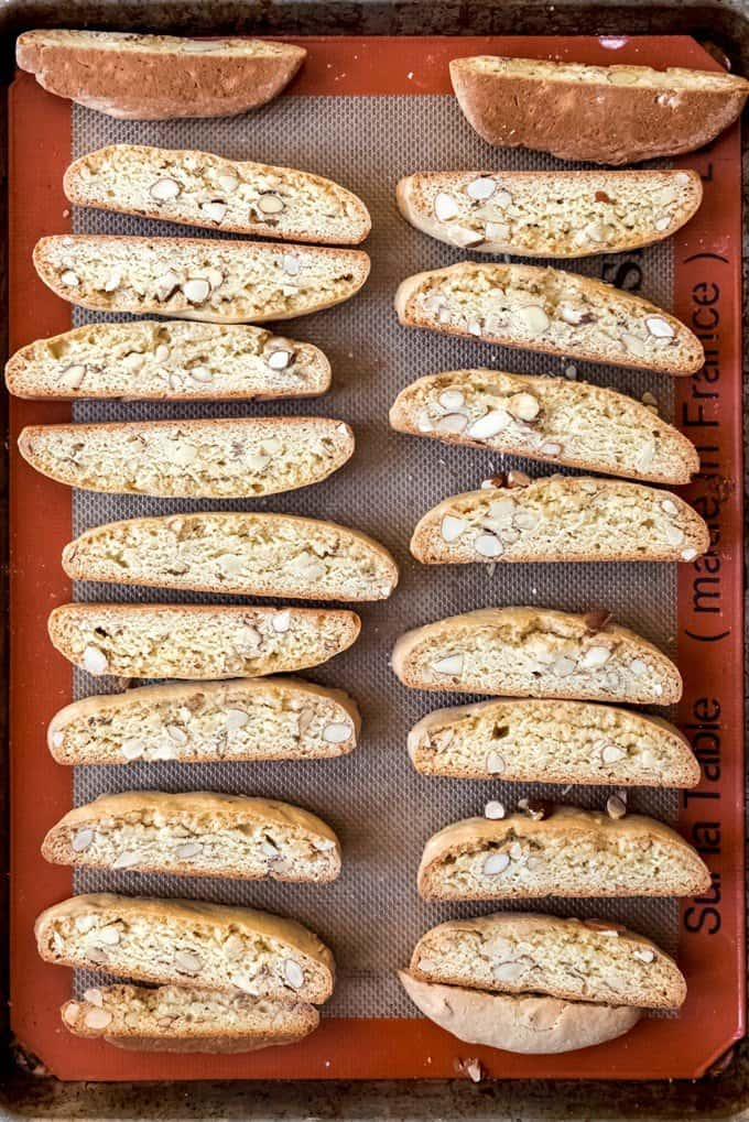 An image of toasted almond biscotti arranged on a baking sheet.
