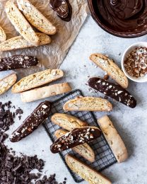 scattered almond biscotti with some dipped in chocolate