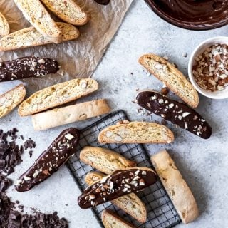Chocolate-Dipped Almond Biscotti are the twice-baked, scrumptiously crunchy and dunkable cookie of Italian origin.  My favorite biscotti cookies are loaded with toasted almonds, baked until crunchy, then dipped in dark chocolate and sprinkled with more chopped almonds for a delightful treat!