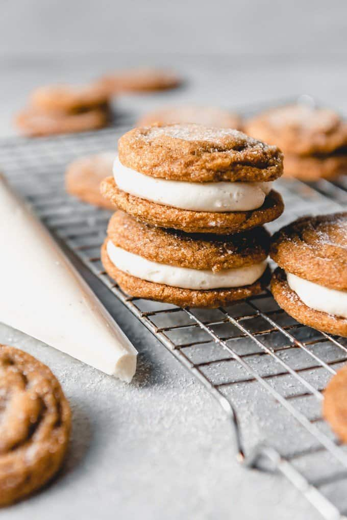 An image of molasses sandwich cookies with eggnog buttercream filling in the middle.