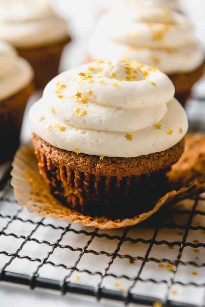 An image of gingerbread cupcakes frosted with eggnog buttercream frosting.