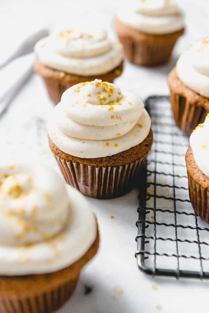 These moist Gingerbread Cupcakes with eggnog buttercream frosting are made from scratch and the perfect handheld non-cookie treat for your holiday party this year!  Made with molasses, ginger, cinnamon, and other spices, these cupcakes taste just like Christmas.