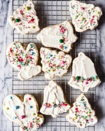 These Oatmeal Rolled Sugar Cookies are an old-fashioned cut-out sugar cookie recipe with a chewy twist thanks to the addition of rolled oats and almond extract.  We love them frosted with buttercream frosting and topped with colorful sprinkles!