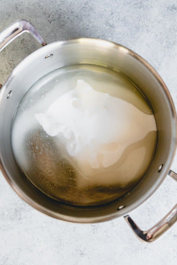 An image of a pan of sugar, water, and corn syrup for making the base of a classic peanut brittle recipe.