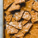 Old-Fashioned Homemade Peanut Brittle is a crispy, crunchy homemade candy loaded with roasted peanuts in a buttery, sweet candy coating.  It's the best peanut brittle EVER and perfect for homemade gift-giving.