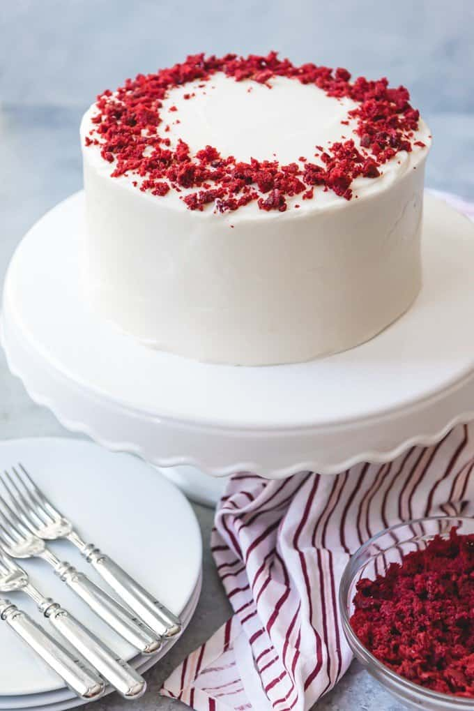 An image of a frosted and decorated red velvet cake that has been made from scratch.