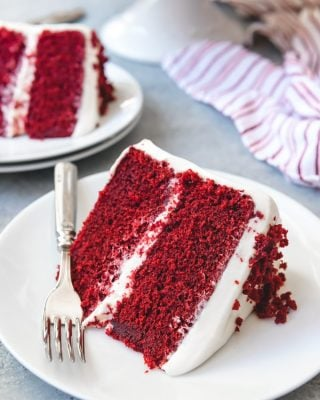 The best Red Velvet Cake has a unique flavor and tender, moist crumb that pairs wonderfully with a tangy, sweet cream cheese frosting. This is a classic cake recipe for a 2-layer red velvet cake that is quite possibly the best red velvet cake recipe in the world.