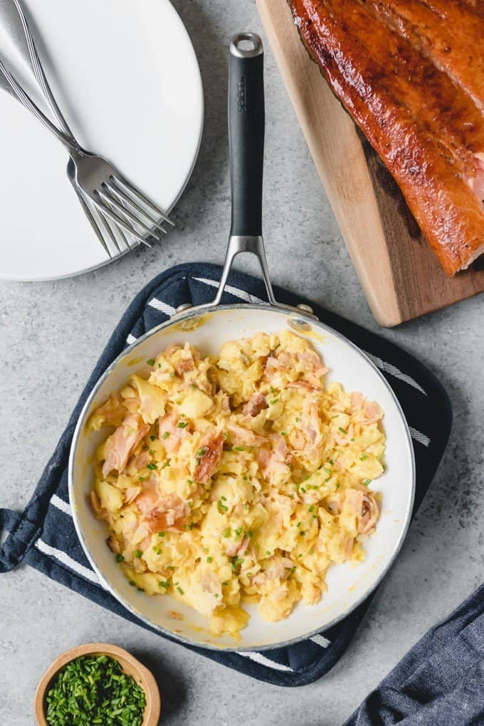 An image of an easy, healthy breakfast of scrambled eggs with salmon and chives.