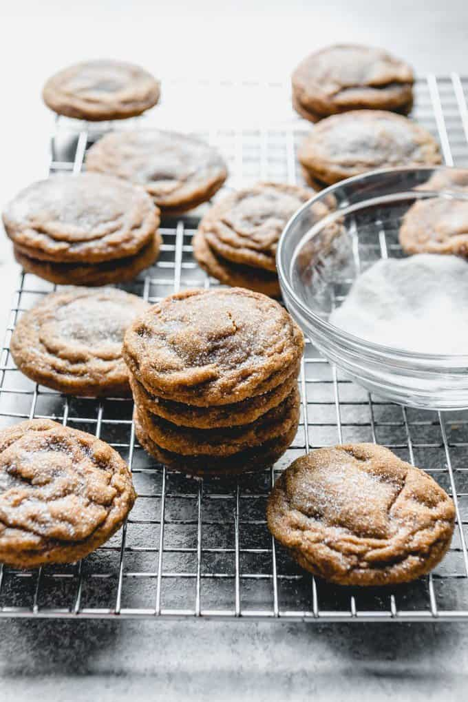 An image of soft and chewy molasses cookies cooling on a wire rack.